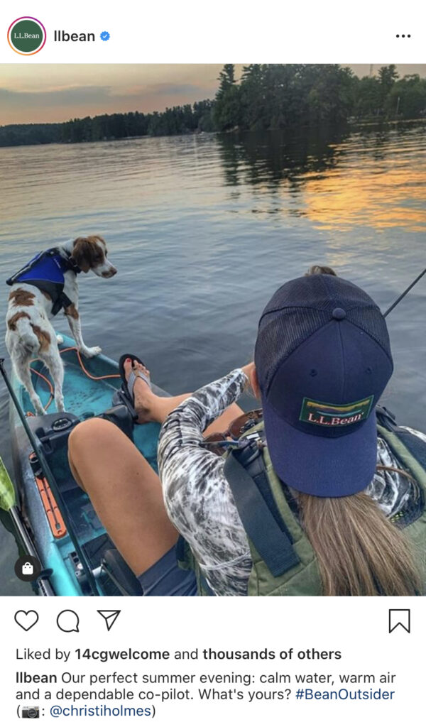 Woman in boat fishing with dog